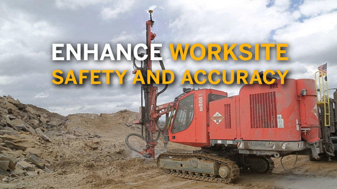 Piling machine driving poles into ground